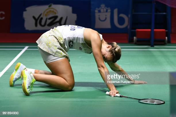Gabrielle Adcock of England falls as she compete against Yuta Watanabe and Arisa Higashino of Japan during the Mixed Doubles Round 2 match on day...
