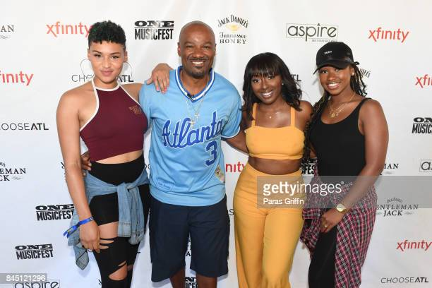 Gabrielle Carreiro, Big Tigger, Ashly Williams, and Shyann Roberts of June's Diary pose Big Tigger at 2017 ONE Music Fest at Lakewood Amphitheatre on...