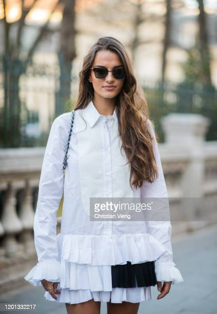 Gabrielle Caunesil seen wearing white button up dress, yellow bag, black boots outside Viktor & Rolf during Paris Fashion Week - Haute Couture...