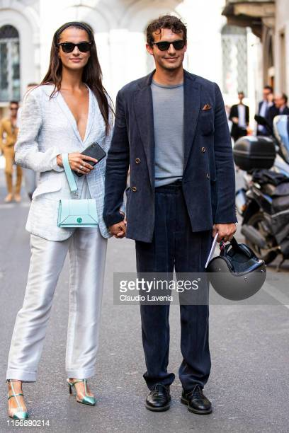 Gabrielle Caunesil wearing a light grey blazer light grey silky trousers teal heels and light blue Giorgio Armani bag and Riccardo Pozzoli wearing a...