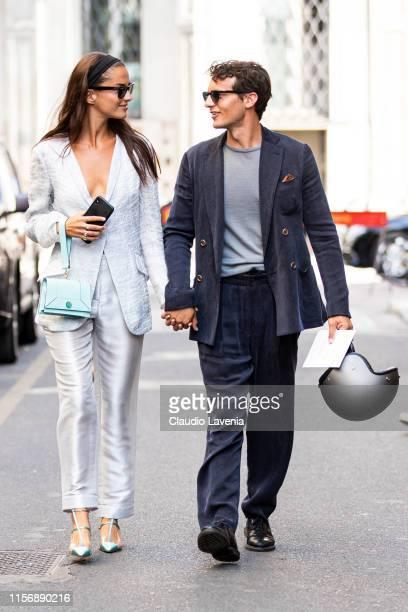 Gabrielle Caunesil , wearing a light grey blazer, light grey silky trousers, teal heels and light blue Giorgio Armani bag, and Riccardo Pozzoli ,...