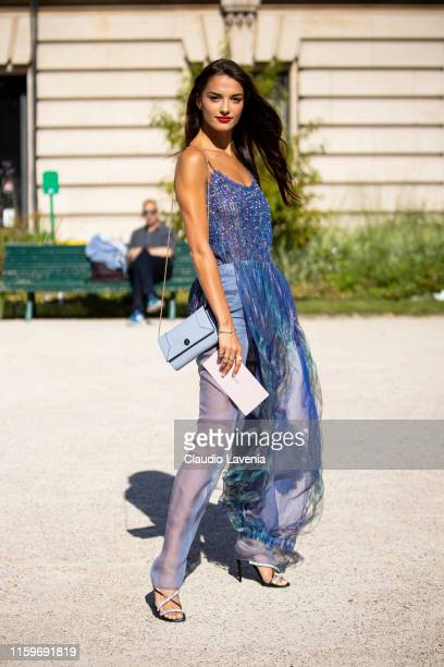 Gabrielle Caunesil wering a blue dress is seen outside Giorgio Armani Prive show during Paris Fashion Week Haute Couture Fall Winter 2019 2020 on...