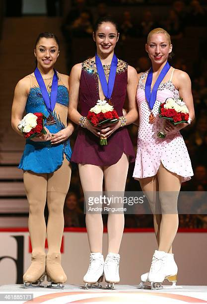 Gabrielle Daleman Kaetlyn Osmond and Amelie Lacoste stand on the podium with their medals during the Senior Women's awards ceremony of the 2014...