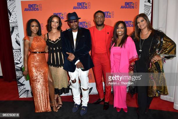 Gabrielle Dennis Alyssa Goss Bobby Brown Woody McClain Sandi McCree and Alicia Etheredge pose in the press room at the 2018 BET Awards at Microsoft...