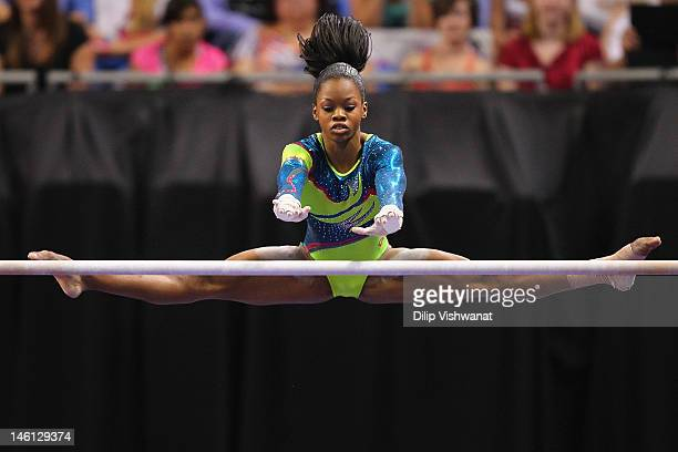 Gabrielle Douglas competes on the uneven bars during the Senior Women's competition on day four of the Visa Championships at Chaifetz Arena on June...