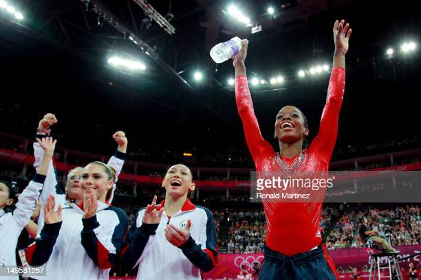 Gabrielle Douglas Kyla Ross and Mc Kayla Maroney of the United States celebrate during the Artistic Gymnastics Women's Team final on Day 4 of the...