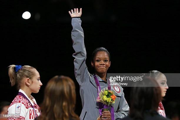 Gabrielle Douglas of the United States celebrates after winning the gold medal in the Artistic Gymnastics Women's Individual AllAround final on Day 6...