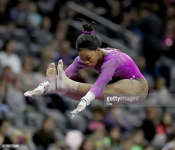 Gabrielle Douglas of the United States competes on the uneven parallel bars during the 2016 ATT American Cup on March 5 2016 at Prudential Center in...