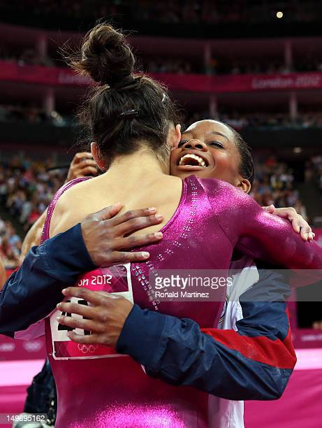 Gabrielle Douglas of the United States hugs Alexandra Raisman after Douglas wins the gold medal in the Artistic Gymnastics Women's Individual...