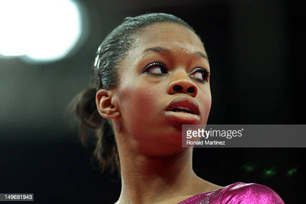 Gabrielle Douglas of the United States looks on before getting on the uneven bars in the Artistic Gymnastics Women's Individual AllAround final on...