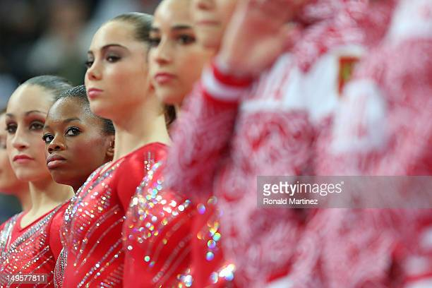 Gabrielle Douglas of the United States of America looks down at her teammates during introductions before the Artistic Gymnastics Women's Team final...