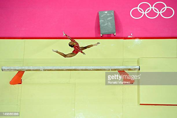 Gabrielle Douglas of the United States performs on the balance beam in the Artistic Gymnastics Women's Team final on Day 4 of the London 2012 Olympic...