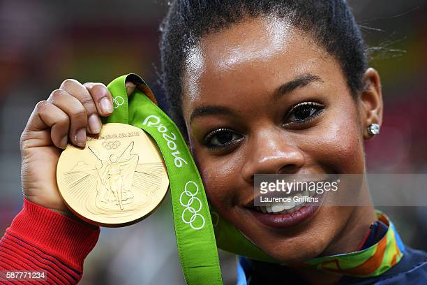 Gabrielle Douglas of the United States poses for photographs with her gold medal after the medal ceremony for the Artistic Gymnastics Women's Team on...