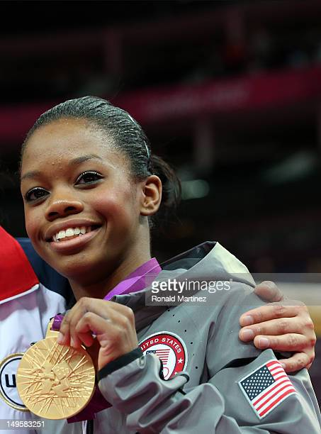 Gabrielle Douglas of the United States poses with the gold medal after helping the United States win the Artistic Gymnastics Women's Team final on...