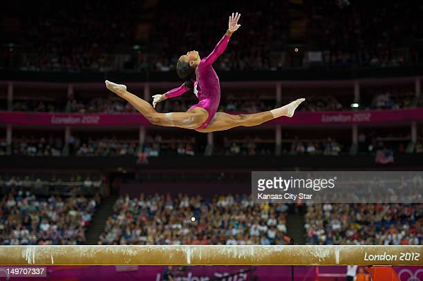 Gabrielle Douglas of the United States soared over the balance beam apparatus during her gold medal performance in the women's gymnastics individual...