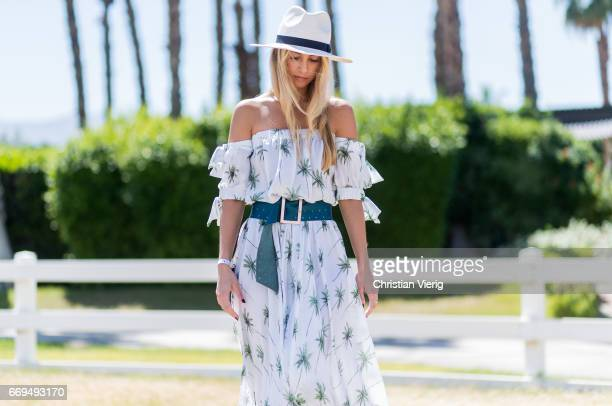 Gabrielle Giacalone wearing a Milly dress hat at the Revovle Festival during day 3 of the 2017 Coachella Valley Music Arts Festival Weekend 1 on...