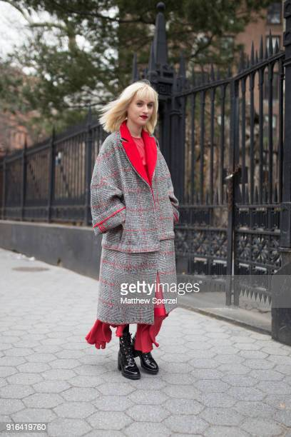 Gabrielle Korn is seen on the street attending Linder during New York Fashion Week wearing a plaid coat with pastel outfit on February 9 2018 in New...