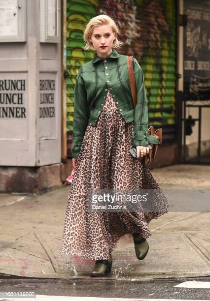 Gabrielle Korn is seen wearing a green striped shirt and leopard pring dress outside the 31 Phillip Lim show during New York Fashion Week Women's S/S...