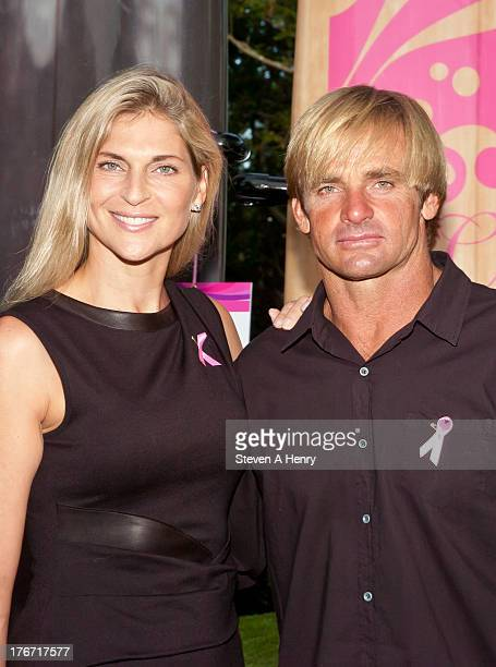 Gabrielle Reece and Laird Hamilton attend the 2nd annual Paddle Party for Pink on August 17 2013 in Sag Harbor New York