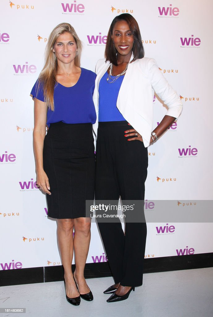 Gabrielle Reece and Lisa Leslie attend day 2 of the 4th Annual WIE Symposium at Center 548 on September 21, 2013 in New York City.