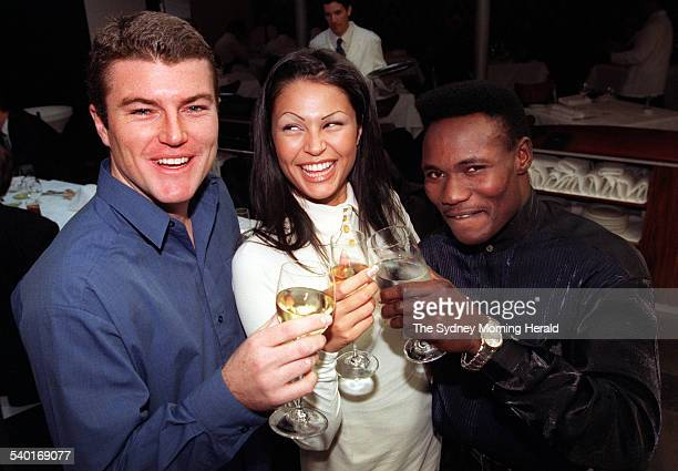 Gabrielle Richens with Australian cricketer Stuart MacGill left and boxer Lovemore Ndu at lunch at the Rockpool on George to launch her new...