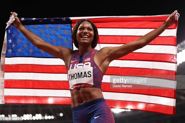 Gabrielle Thomas of Team United States celebrates with her countries flag after winning the bronze medal in the Women's 200m Final on day eleven of...