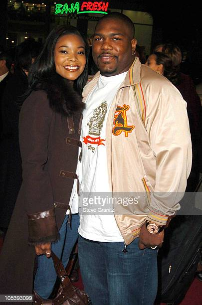 Gabrielle Union and Chris Howard during Coach Carter Los Angeles Premiere Arrivals at Grauman's Chinese Theatre in Hollywood California United States