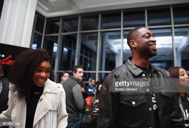 Gabrielle Union and Dwyane Wade are seen at Stance Spades Tournament during NBA AllStar Weekend on February 18 2018 in Los Angeles California
