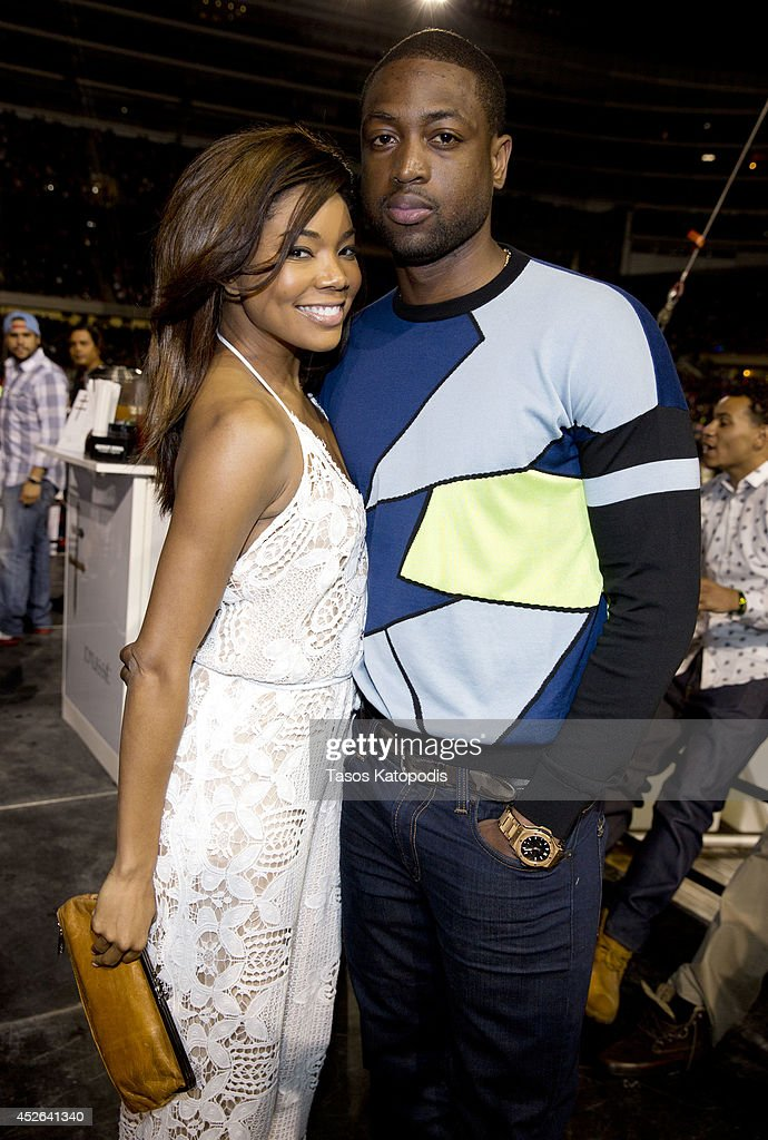 Gabrielle Union and Dwyane Wade attend the D'USSE VIP Riser and Lounge at On The Run Tour Chicago at Soldier Field on July 24, 2014 in Chicago, Illinois.
