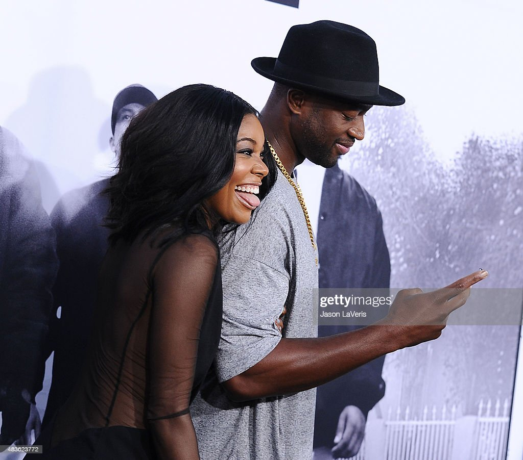 Gabrielle Union and Dwyane Wade attend the premiere of 'Straight Outta Compton' at Microsoft Theater on August 10, 2015 in Los Angeles, California.