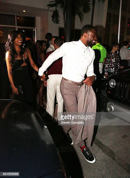 Gabrielle Union and Dwyane Wade leave their wedding rehearsal dinner at Prime 112 Steakhouse on August 29 2014 in Miami Beach Florida