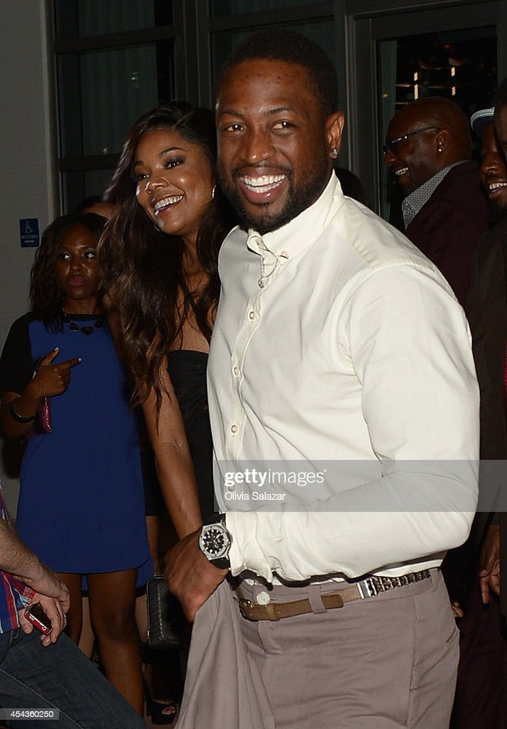 Gabrielle Union and Dwyane Wade leave their wedding rehearsal dinner at Prime 112 Steakhouse on August 29, 2014 in Miami Beach, Florida.