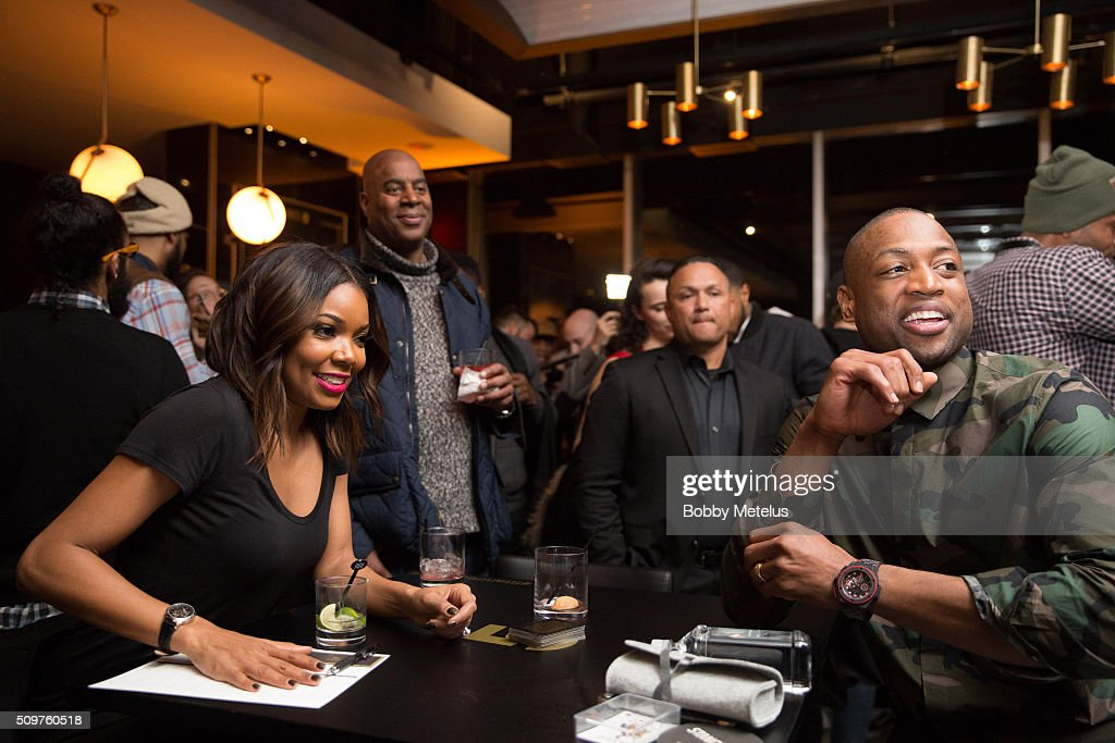 Gabrielle union and Dwyane Wade looks on during the Dwyane Wade and Stance Stocks Spades Tournament at The One Eighty on February 11, 2016 in Toronto, Canada.