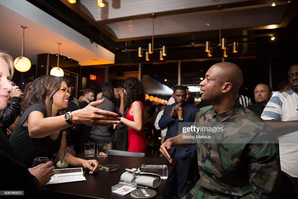 Gabrielle Union and Dwyane Wade share a moment during the Dwyane Wade and Stance Stocks Spades Tournament at The One Eighty on February 11, 2016 in Toronto, Canada.