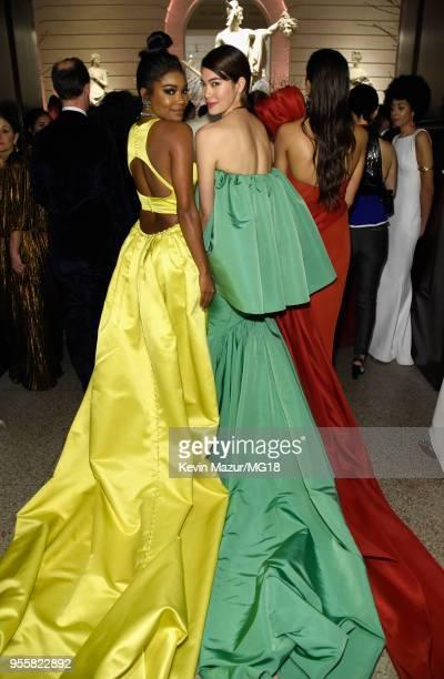 Gabrielle Union and Hikari Mori attend the Heavenly Bodies Fashion The Catholic Imagination Costume Institute Gala at The Metropolitan Museum of Art...