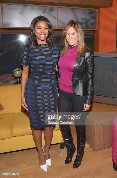 Gabrielle Union and Karla Martínez is on the Set Of 'Despierta America' at Univision Headquarters on November 19 2014 in Miami Florida