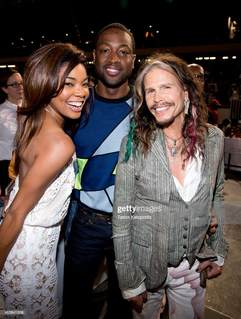 Gabrielle Union, Dwyane Wade and Steven Tyler attends the D'USSE VIP Riser and Lounge at On The Run Tour Chicago at Soldier Field on July 24, 2014 in Chicago, Illinois.