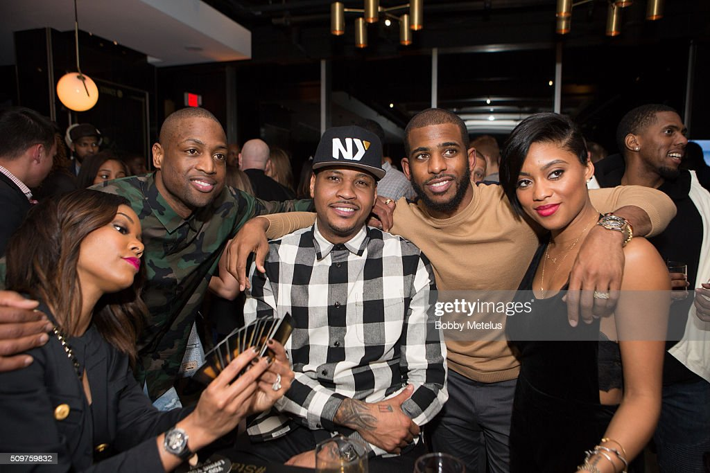 Gabrielle Union, Dwyane Wade, Carmelo Anthony, Chris Paul and Jada Paul take a break from playing cards to take a photo during the Dwyane Wade and Stance Stocks Spades Tournament at The One Eighty on February 11, 2016 in Toronto, Canada.