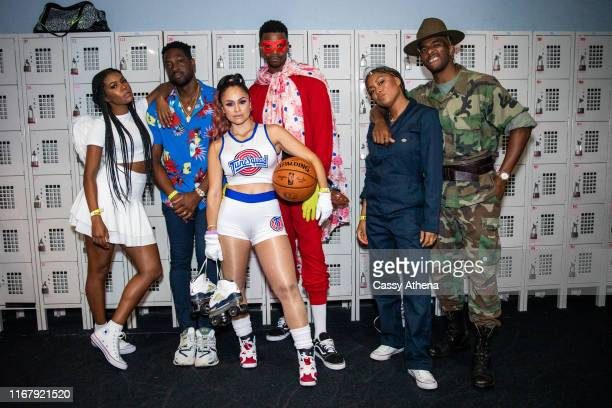 Gabrielle Union Dwyane Wade Mia Wright Dorell Wright Jada Paul and Chris Paul pose together at the Wright Legacy Foundation skate night at World on...