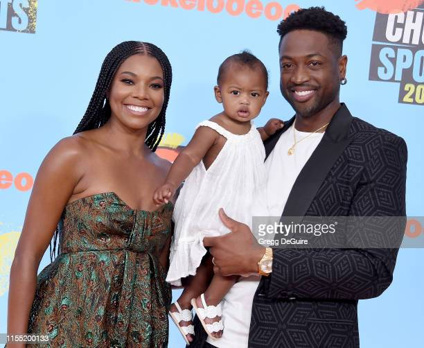 Gabrielle Union, Kaavia James Union Wade, and Dwyane Wade attend Nickelodeon Kids' Choice Sports 2019 at Barker Hangar on July 11, 2019 in Santa...