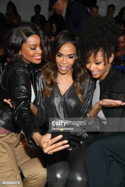 Gabrielle Union shares a moment on the front row with Destiny's Child Michelle Williams and actress Yaya Dacosta at Dwyane Wade's A Night on the...