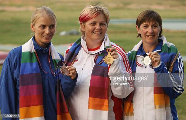 Gaby Ahrens of Namibia Anita North of England and Shona Marshall of Scotland pose with their medals after the Womens Singles Trap final at the Dr...