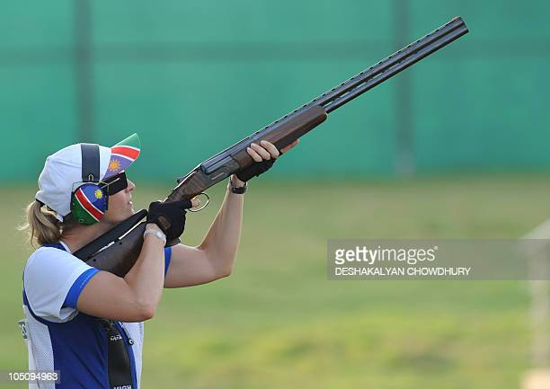 Gaby Ahrens of Namibia who won bronze competes in the women's singles trap shooting at the Dr Karni Singh Shooting Range of the XIX Commonwealth...