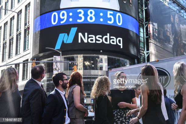 Gaby Dabrowski laughs with other members of the Women's Tennis Association in Times Square after ringing the opening bell at NASDAQ on August 29 2019...