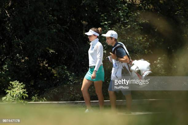 Gaby Lopez of Mexico and her caddie cross the footbridge on the third hole during the first round of the Marathon LPGA Classic golf tournament at...