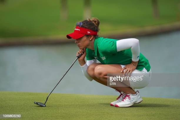 Gaby Lopez of Mexico lines up a putt during the final round of the Blue Bay LPGA golf tournament in Sanya on China's Hainan Island on November 10...