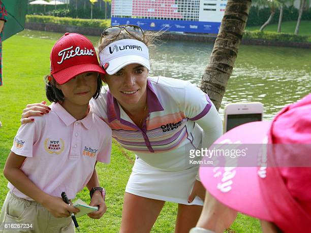 Gaby Lopez of Mexico poses a picture with fans after her match at Round 3 of Blue Bay LPGA on Day 3 on October 22 2016 in Hainan Island China