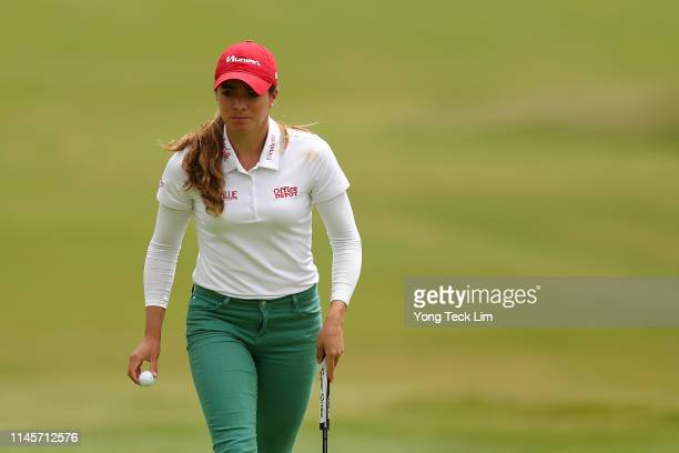Gaby Lopez of Mexico reacts after sinking a putt on the first hole during the final round of the HUGELAIR PREMIA LA Open at Wilshire Country Club on...