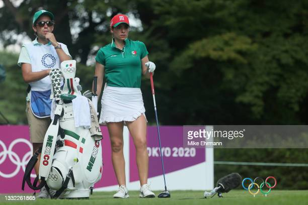 Gaby Lopez of Team Mexico waits with her caddie Alvaro Alonso Prada on the 18th tee during the first round of the Women's Individual Stroke Play on...