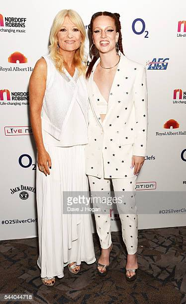 Gaby Roslin and Jess Glynne pose for a photo during the Nordoff Robbins O2 Silver Clef Awards on July 1 2016 in London United Kingdom